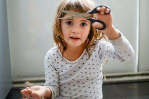 ROCK STAR little girl giving herself a haircut