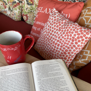 conflict - image of an open book, coffee mug surrounded by pillows