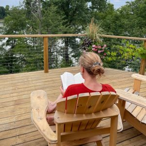 pic of Sarah McVanel reading on the deck her book recommendations from the back