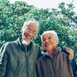 Awe with Sarah McVanel - image elderly couple taking a walk in nature